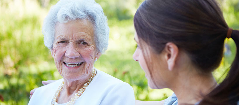 senior taling to younger woman