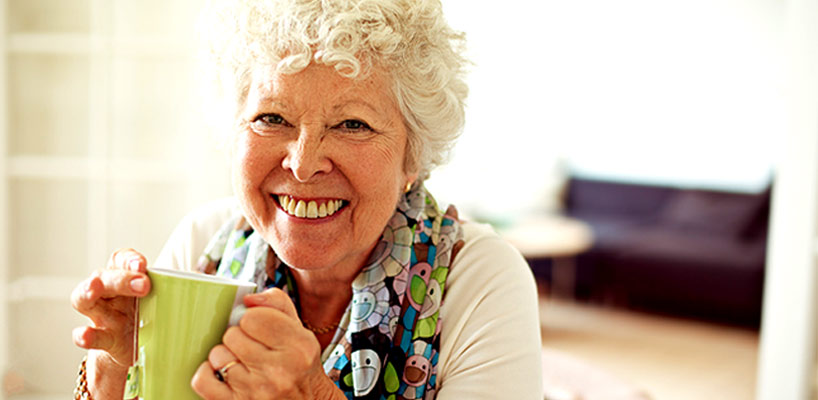 Senior woman aging in place happily and drinking tea