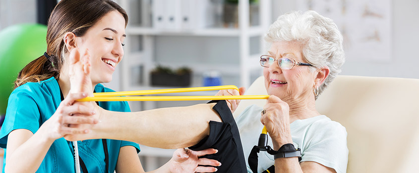 Senior with Physcial Therapist